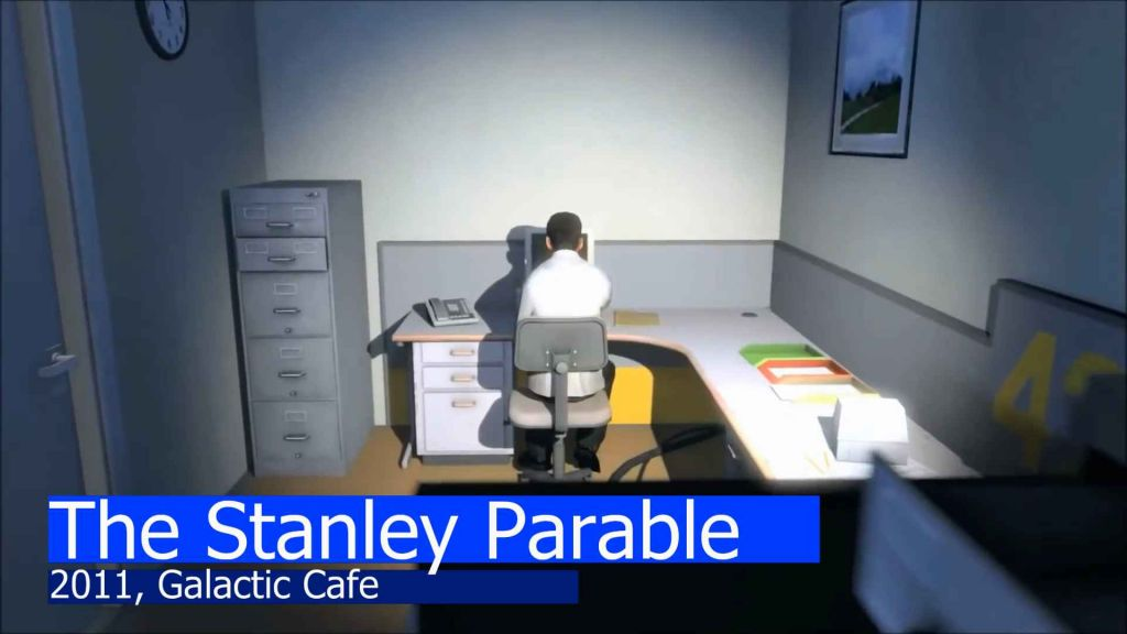 Stanley, sitting at his desk