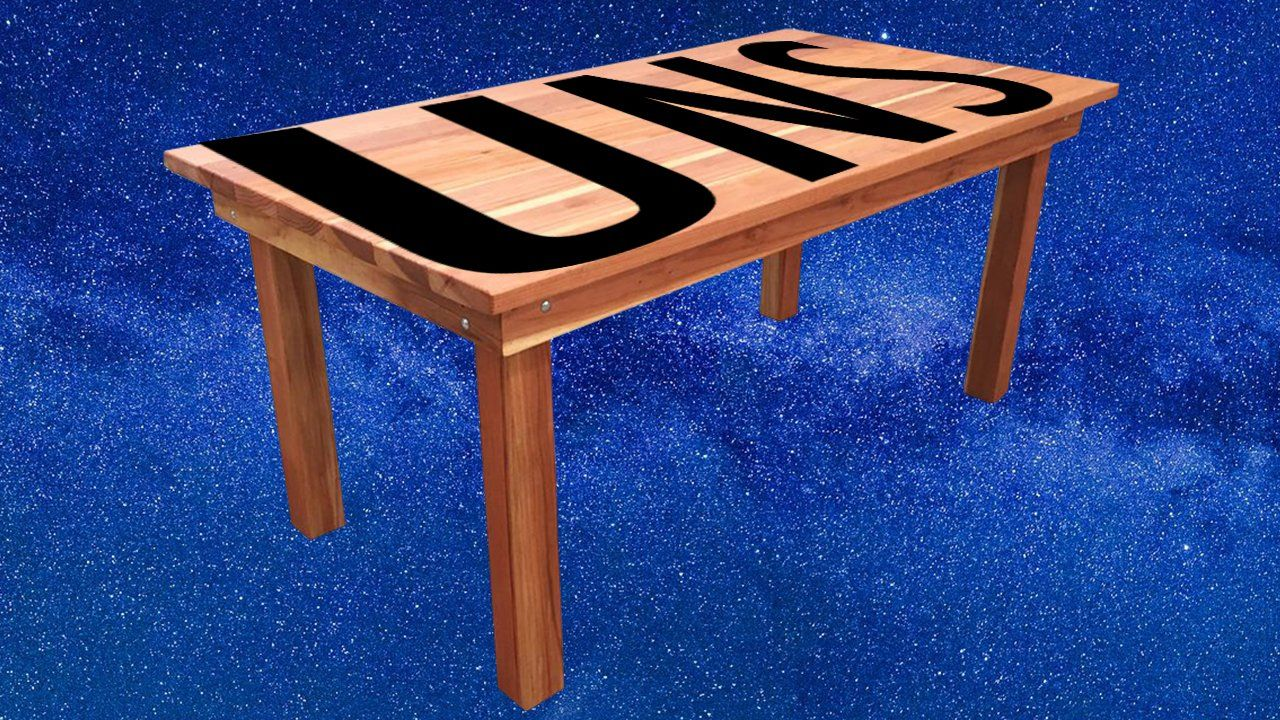 """A table with """"UNS"""" written on top"""