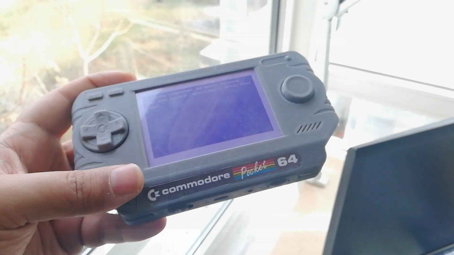 A new plastic looking Commodore handheld
